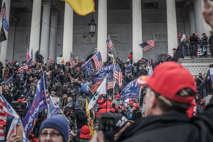Trump supporters take the steps on the east side of the U.S. Capitol building on Jan. 6, 2021, in Washington, D.C.