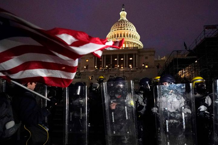 Police in riot gear in front of the U.S. Capitol on Jan. 6