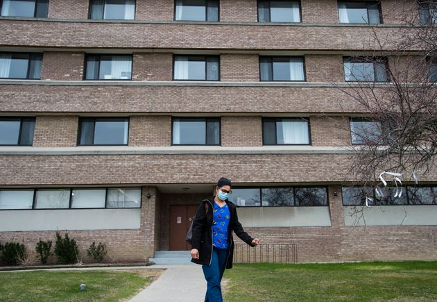 A health-care worker leaves after finishing her shift for the day at the Eatonville Care Centre in Toronto...
