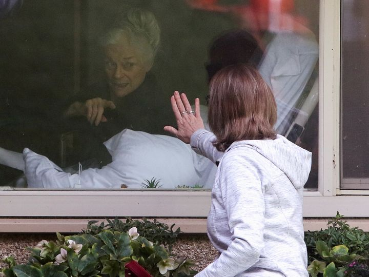 Lori Spencer visits her mom Judie Shape, 81, in a Seattle-area nursing home that was one of the first U.S. hotspots for COVID