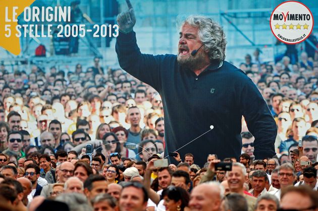 Supporters listen as founder Beppe Grillo speaks at the 5-Star Movement party's open-air rally at Circo...
