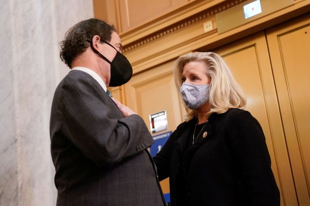 Rep. Jamie Raskin (D-MD) talks with Rep. Liz Cheney (R-WY) in the U.S. Capitol after the House voted...