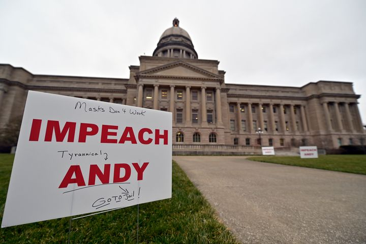 Protesters lined the walkway to the Kentucky state Capitol with signs calling for Beshear's impeachment earlier this month. A