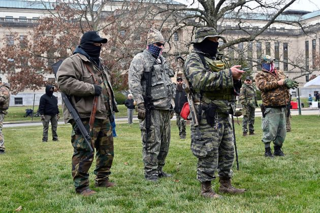 Armed protesters gathered at the Kentucky state Capitol in Frankfort on Saturday, just days after the...