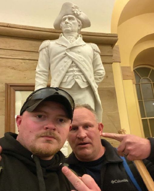 Police officers Jacob Fracker and Thomas Robertson took a selfie inside the U.S. Capitol during an insurrection.