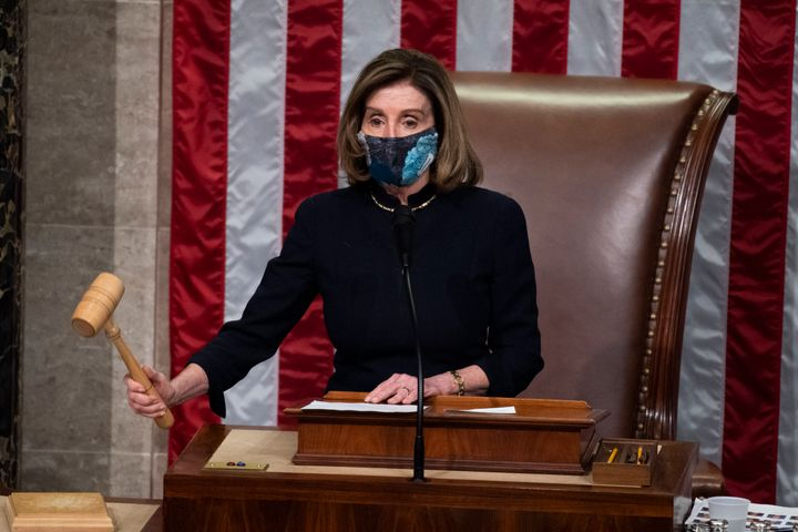 Speaker Nancy Pelosi (D-Calif.), gavels into recess after the House voted to impeach President Donald Trump on Wednesday, Jan
