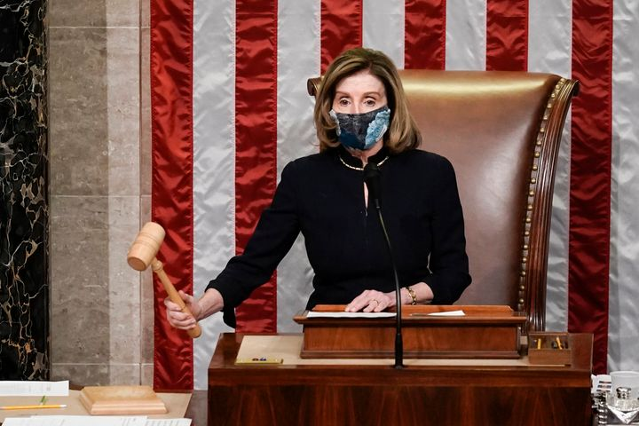 Speaker of the House Nancy Pelosi (D-Calif.) gavels in the final vote of the historic second impeachment of President Donald