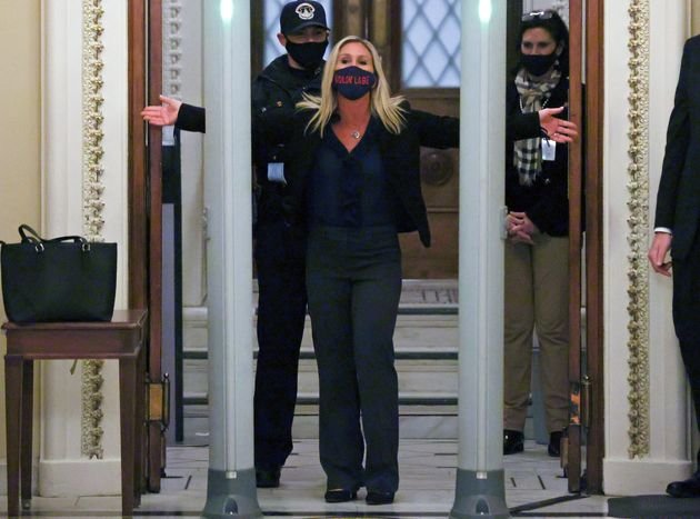 Rep. Marjorie Taylor Greene (R-Ga), a QAnon conspiracy theorist, is searched outside the House chamber...