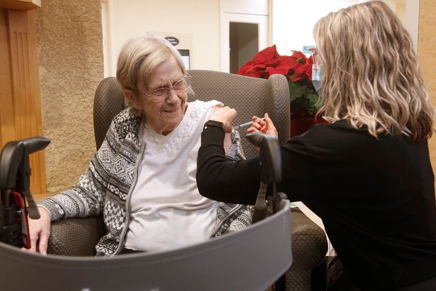 Paramedic Jessi Bittner inoculates Margaret Watson, 94, a resident at Oakview Place Long Term Care Residence, with her COVID-19 vaccine in the Winnipeg care home on Monday.