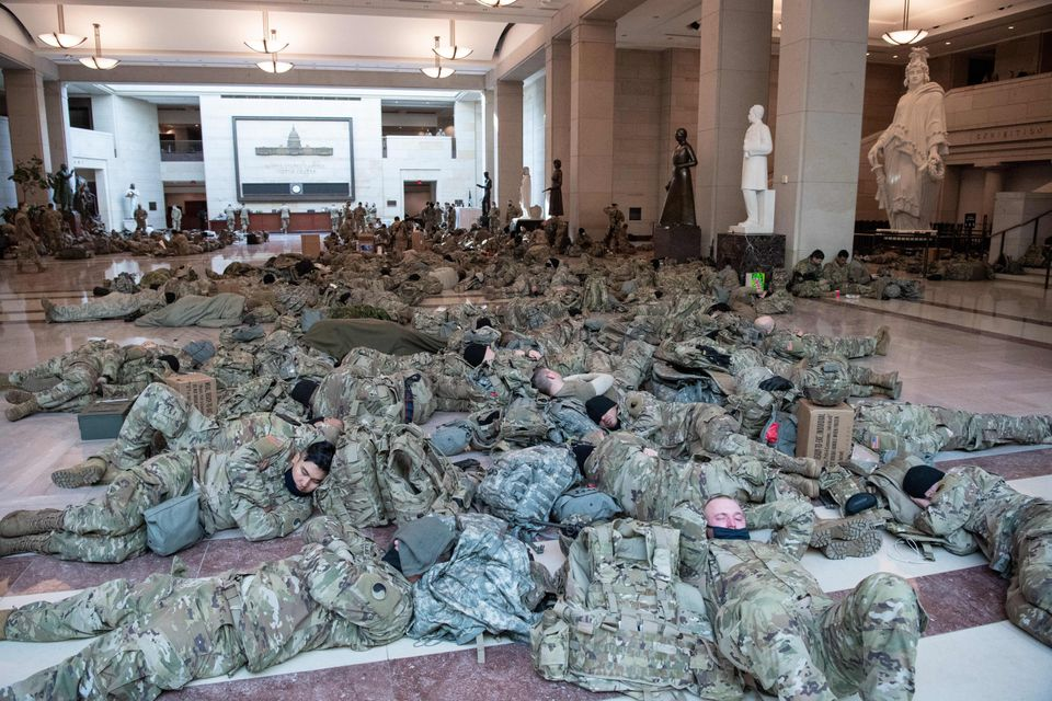 Members of the National Guard rest in the Capitol Visitors Center on Capitol Hill in Washington, DC,...