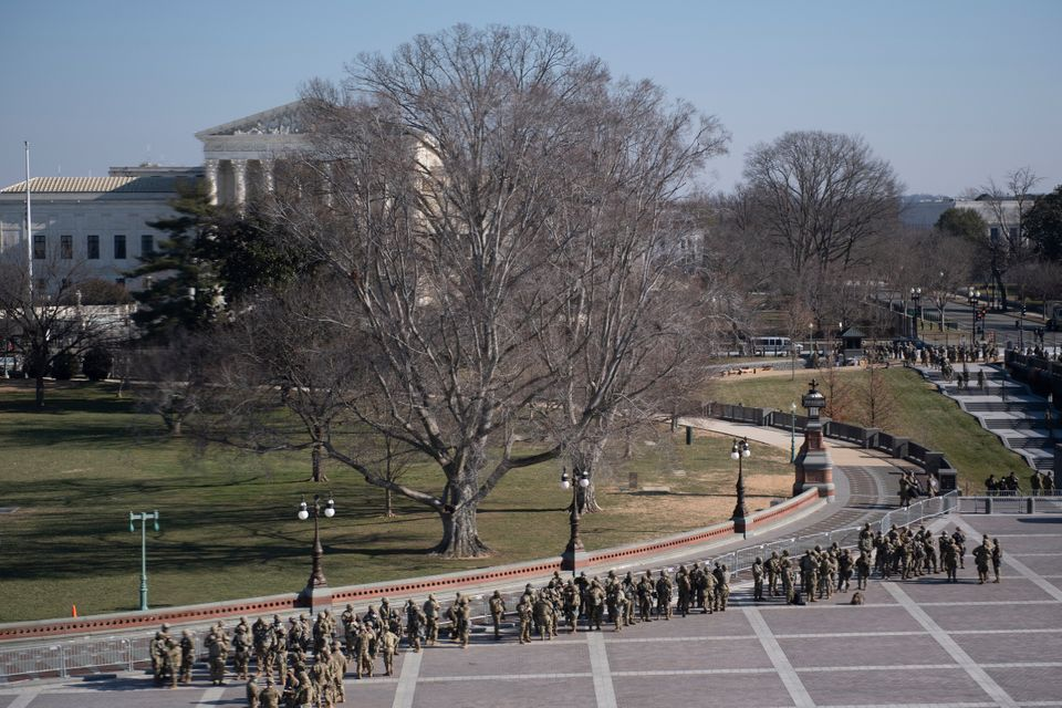 Members of the National Guard guard Capitol Hill grounds in Washington, DC, January 13, 2021. - The Democrat-controlled...