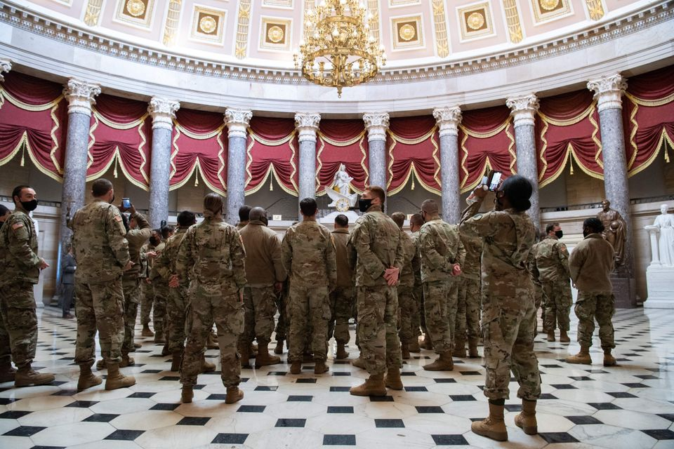Members of the National Guard walk through Statuary Hall of the US Capitol in Washington, DC, January...