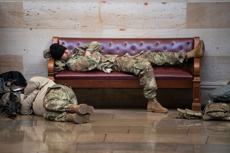 UNITED STATES - January 13: Members of the National Guard rest in the Rotunda as the House of Representatives...