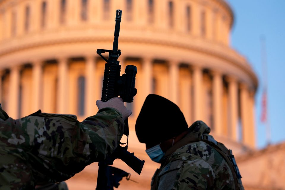 WASHINGTON, DC - JANUARY 13: Weapons are distributed to members of the National Guard outside the U.S....