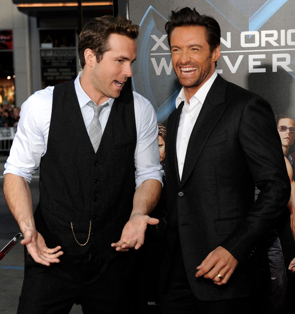 Ryan Reynolds, left, and Hugh Jackman arrive to the