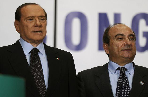 Italian Prime Minister Silvio Berlusconi (L) is greeted on stage by Domenico Scilipoti, the general secretary...