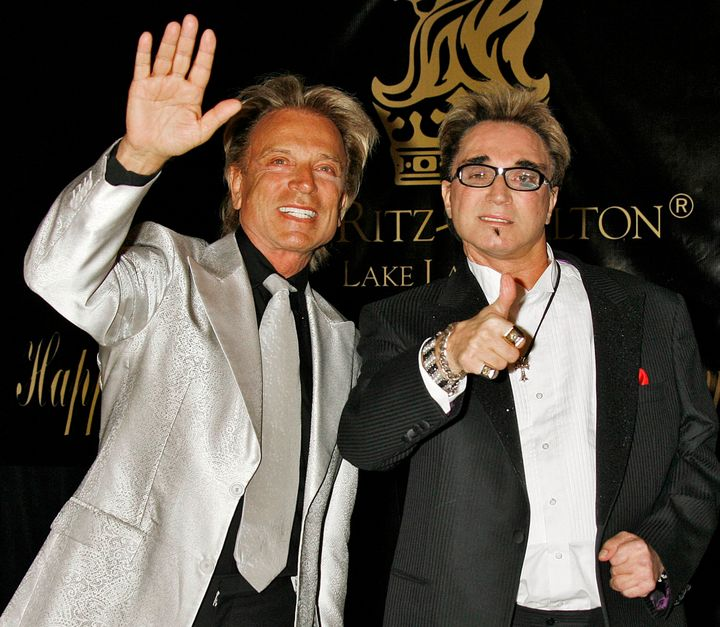 Siegfried Fischbacher, left, and Roy Horn, right, pictured at Elizabeth Taylor's 75th birthday party in 2007.