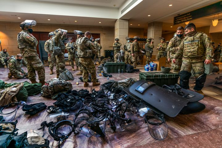 Members of the National Guard gather inside the Capitol Visitor Center, Wednesday, Jan. 13, 2021, in Washington as the House