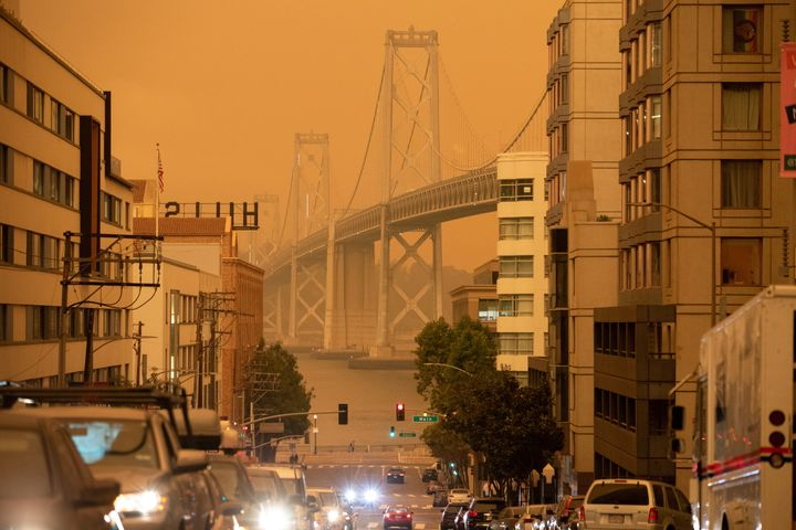 The Bay Bridge in San Francisco is seen under an orange sky darkened by the smoke from California wildfires on Sept. 9, 2020.
