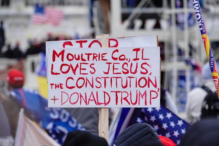 """A sign referencing Jesus is held aloft during a """"Stop the Steal"""" rally in support of President Donald Trump in Washington, D.C., on Jan. 6."""