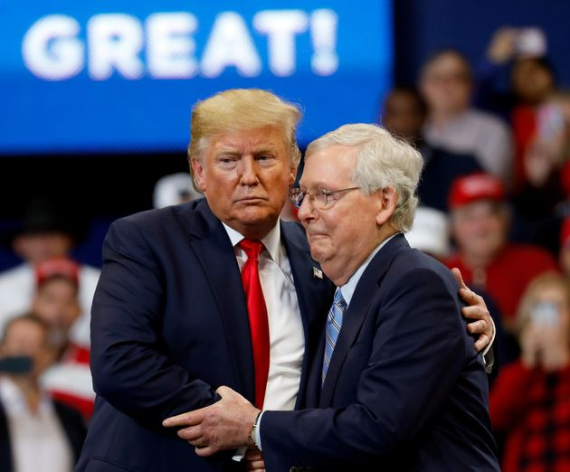 Senate Majority Leader Mitch McConnell (R-Ky.) hugs President Donald Trump at a campaign rally in Lexington,...