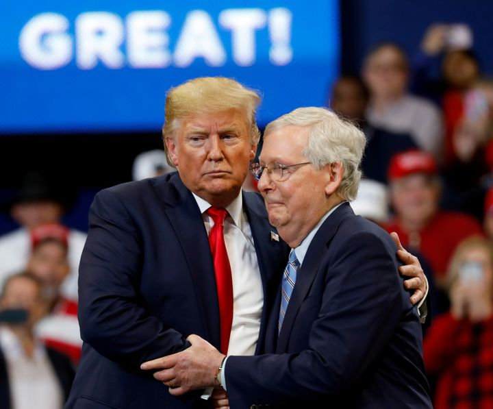 Senate Majority Leader Mitch McConnell (R-Ky.) hugs President Donald Trump at a campaign rally in Lexington, Kentucky, in November 2019.