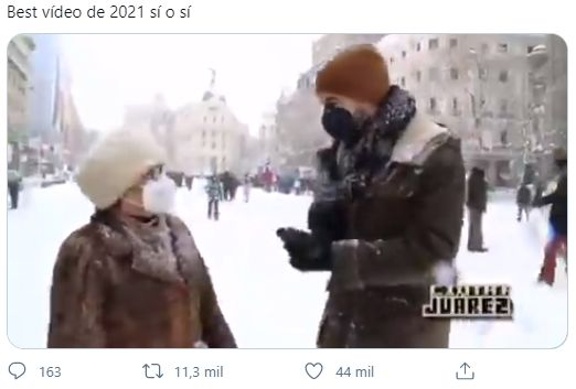 The journalist interviews a woman during the storm in
