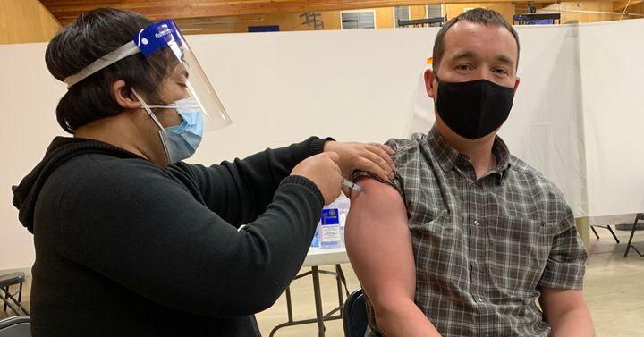 Arviat, Nunavut Mayor Joe Savikataaq Jr. received a shot of the Moderna vaccine at the community hall on Jan. 13, 2021.