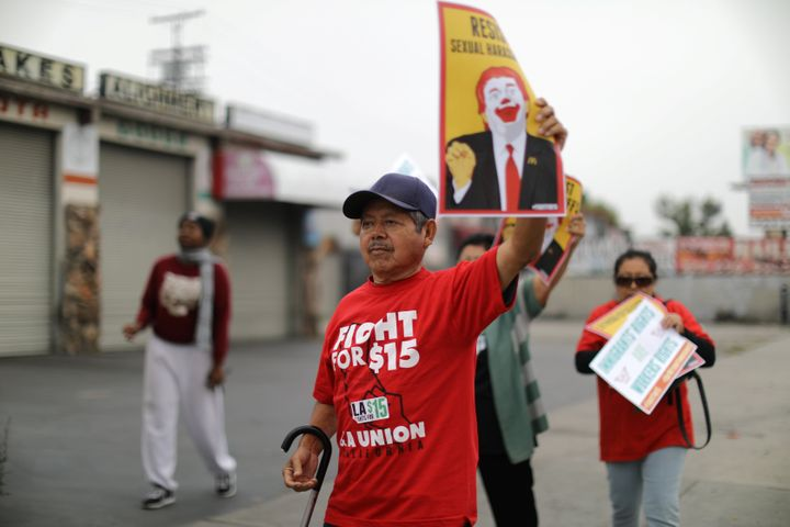 Fast-food workers protest outside of a McDonald's in Los Angeles on May 24, 2017, as part of the Fight for $15 movement. Figh