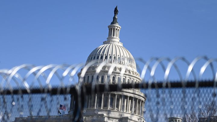 Barbed wire is installed on the top of a security fence surrounding the U.S. Capitol in Washington on Thursday ahead of next week's presidential inauguration of Joe Biden.