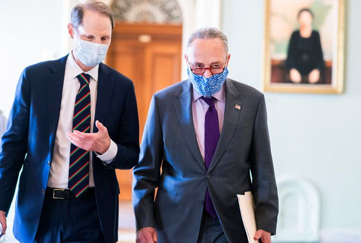 Senate Democratic Leader Chuck Schumer (D-N.Y.), right, and Sen. Ron Wyden, (D-Ore.), will be instrumental to negotiations on