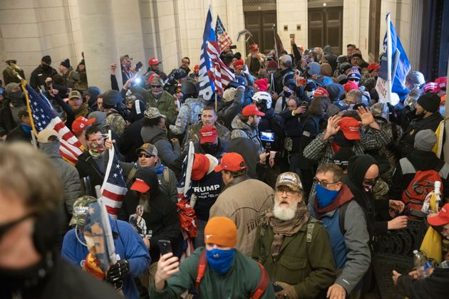 Trump supporters gather near the east front door of the U.S. Capitol after groups breached the building's...