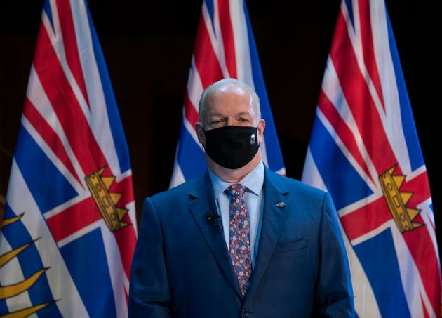 B.C. Premier John Horgan wears a protective face mask to help prevent the spread of COVID-19 on Nov....