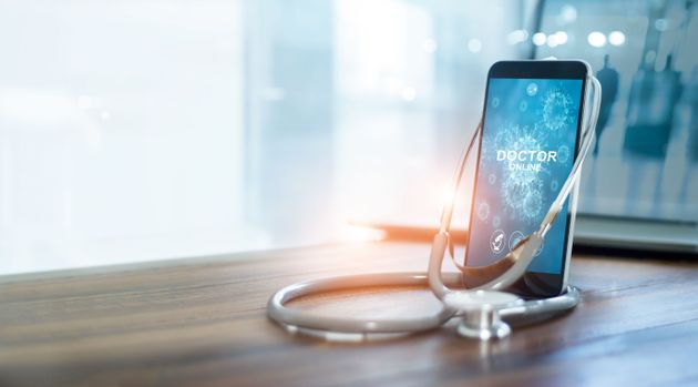 Doctor through the smartphone screen, Doctor online, Online medical communication with patient and analysis...