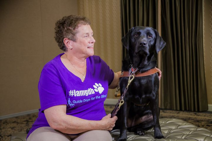 The author and Dime at a Guide Dogs for the Blind alumni reunion in San Francisco in 2017.