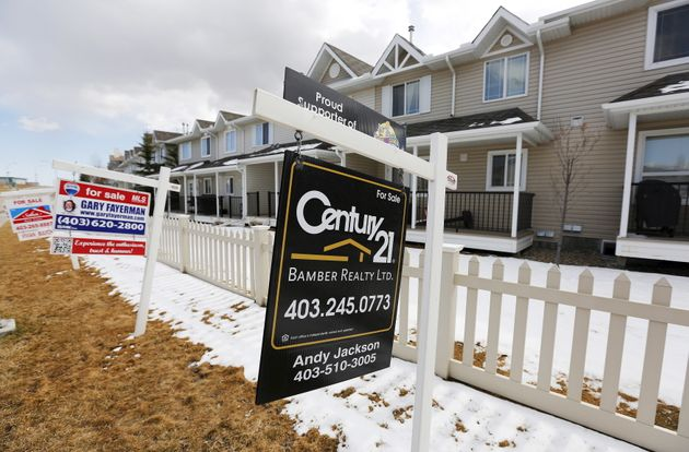 For sale signs are spotted in Calgary in April 2015. CREA says some 551,392 homes were sold in 2020 in