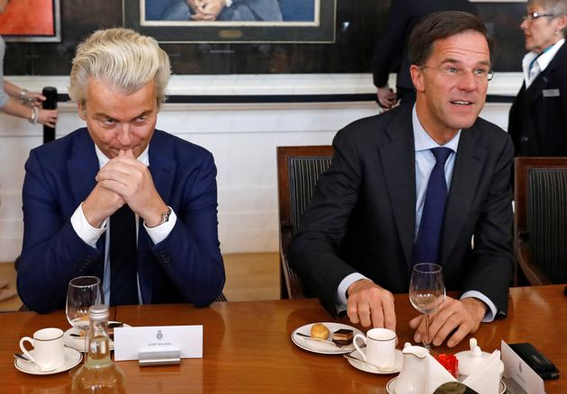 Dutch Prime Minister Mark Rutte (R) of the VVD Liberal party and Dutch far-right politician Geert Wilders...