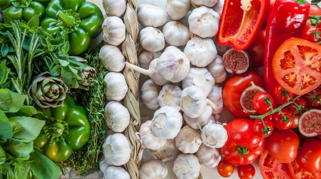 The Italian Flag Made Up Of Fresh Vegetables, Garlic, Tomatoes, Peppers, And