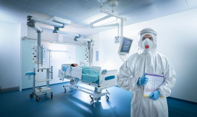 A nurse wears protective gear in an intensive care unit during the Covid-19 global