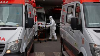 A patient arrives at the 28 de Agosto Hospital in Manaus, Amazon State, Brazil, on January 14, 2021, amid the novel coronavirus, COVID-19, pandemic. - Manaus is facing a shortage of oxygen supplies and bed space as the city has been overrun by a second surge in COVID-19 cases and deaths. (Photo by Michael DANTAS / AFP) (Photo by MICHAEL DANTAS/AFP via Getty Images)