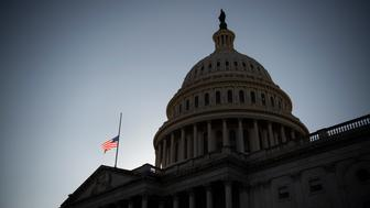 UNITED STATES - January 12: A flag is flown at half staff on the East Front of the Capitol to honor two U.S. Capitol Police officers who died following the violence on Capitol Hill last Wednesday in Washington on Tuesday, Jan. 12, 2021. (Photo by Caroline Brehman/CQ-Roll Call, Inc via Getty Images)