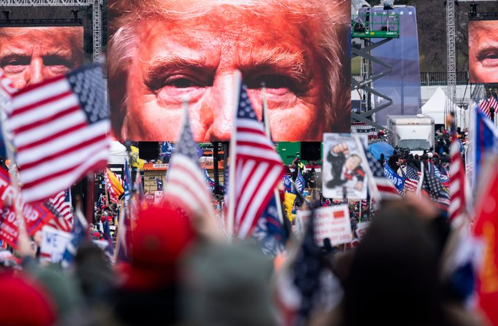 An image of President Donald Trump appears on video screens before his speech to his supporters on Jan. 6, 2021.