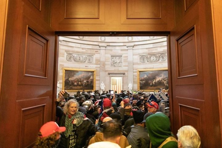 Pro-Trump insurrectionists storm the Capitol after President Donald Trump told them to march on the building to stop Congress
