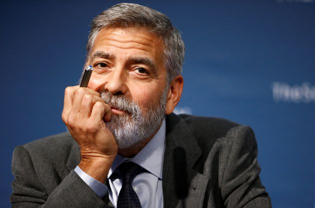 George Clooney attends a news conference during an event about corruption in Africa, in London, Britain...