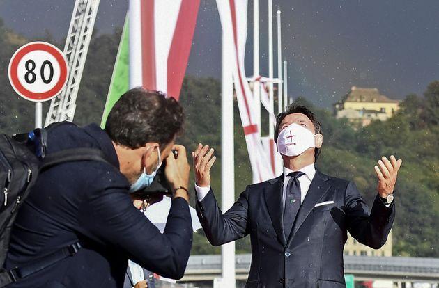 Italian Prime Minister Giuseppe Conte poses on the new Genoa bridge ahead of its official inauguration,...