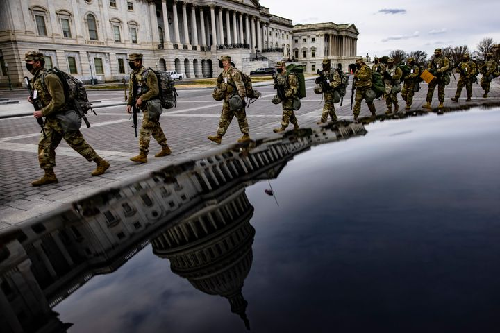 Virginia National Guard troops march across the east front of the U.S. Capitol on their way to their guard posts on Jan. 16 i