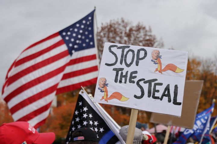 """A placard reading """"Stop the steal"""" is seen during a protest after media announced that Democratic presidential nominee Joe Bi"""