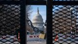 With the U.S. Capitol in the background, a lock on anti-scaling security fencing is seen on Saturday, Jan. 16, 2021, in Washington as security is increased ahead of the inauguration of President-elect Joe Biden and Vice President-elect Kamala Harris. (AP Photo/Jacquelyn Martin)