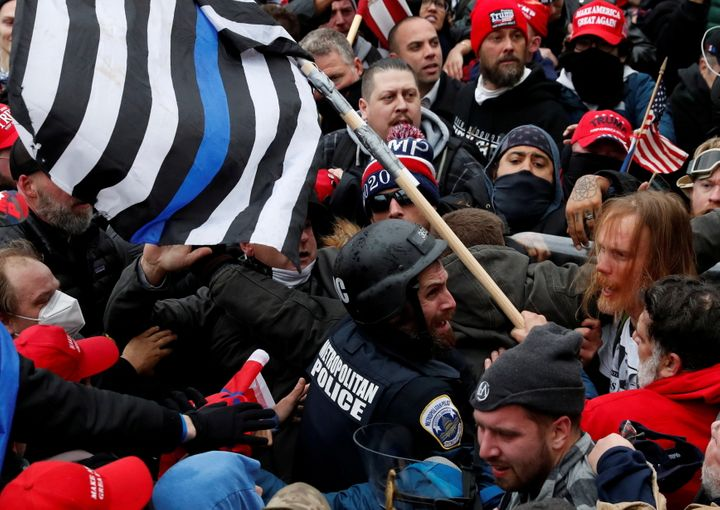 Pro-Trump protesters clash with D.C. police officer Michael Fanone at a rally to contest the certification of the 2020 presid