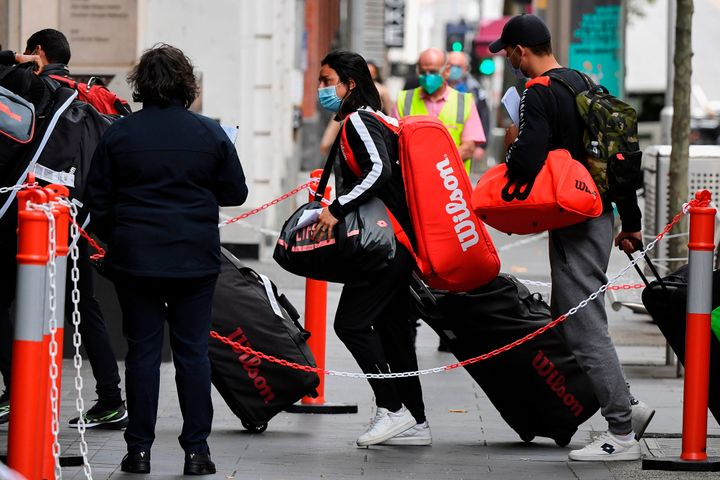Tennis players, coaches and officials arrive at a hotel in Melbourne on January 15, 2021, before quarantining for two weeks ahead of the Australian Open tennis tournament.